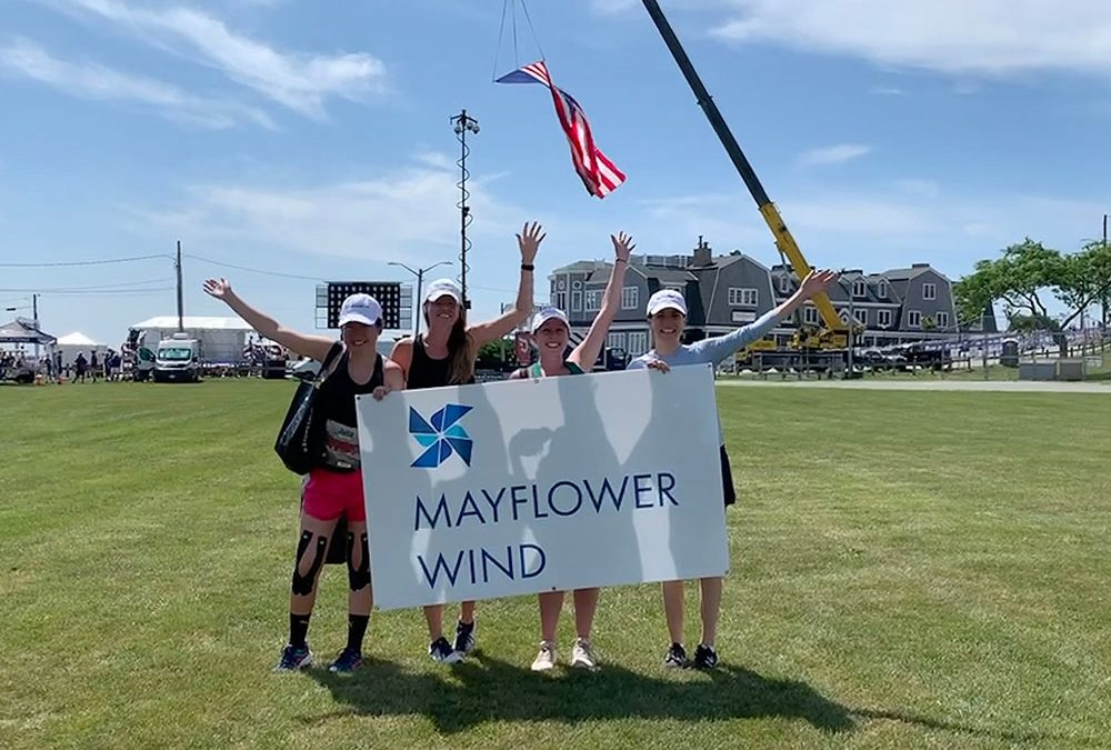 Runners with Mayflower Sign at Falmouth Road Race